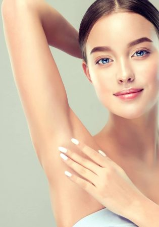 Young,Woman,Holding,Her,Arms,Up,And,Showing,Underarms,,Armpit